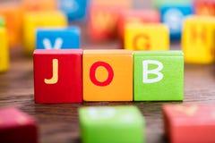 Job Word On Colorful Blocks Stockfotos