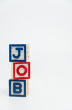 JOB word wooden block arrange in vertical style on white background and selective focus Royalty Free Stock Photo