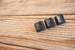 JOBBET skrev med tangentbordtangenter Royaltyfri Foto