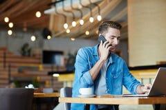 Freelancer in cafe Stock Image
