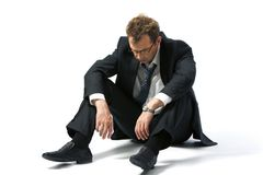 Jobless man. Portrait of stressed businessman left to the mercy of fate Royalty Free Stock Photo