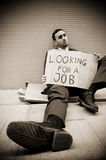 Jobless man. Young businessman holding sign Looking for a job Royalty Free Stock Photography