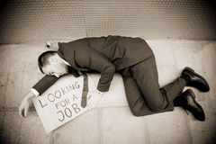 Jobless man. Young businessman holding sign Looking for a job Royalty Free Stock Photo