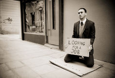 Jobless man. Young businessman holding sign Looking for a job Royalty Free Stock Photos