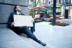 Jobless man. Unemployed businessman holding a blank cardboard sign Stock Image
