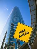 Jobs ahead. Sign in front of a corporate building Stock Photography