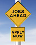 Jobs Ahead. Conceptual road sign on jobs or employment Royalty Free Stock Image