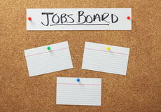 Jobs Board. Banner on a cork notice board with blank white note cards as a concept for job searching and employment opportunities stock photography