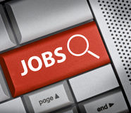 Jobs. Finding Jobs button on red keyboard stock photography