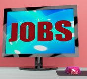 Jobs On Monitor Shows Employment Or Hiring Online Stock Images