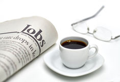 Jobs newspaper with coffee. Jobs newspaper and cup of coffee on white background with shallow depth of field Stock Photo