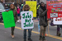 Jobs Not Jails. Washington, DC - January 16, 2017: People holding signs advocating for improved employment opportunities during the Martin Luther King, Jr. Day royalty free stock photography