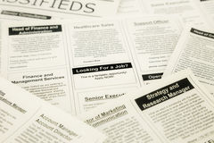 Jobs search on classifieds and newspaper Royalty Free Stock Image