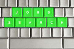 Jobs search spelled on a metallic keyboard Stock Images