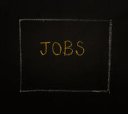 JOBS word on black background. Royalty Free Stock Photography