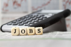 Jobs. Word built with letter cubes royalty free stock photos