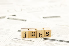 Jobs wording stack on newspaper ads Royalty Free Stock Photos
