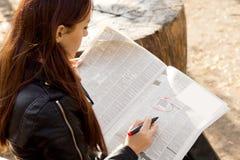 Jobseeker reading the classified adverts Stock Image