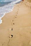 Jobstepps im Sand Stockbild
