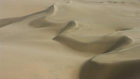 Jobstepps im Sand, der zum Horizont ausdehnt Lizenzfreie Stockfotos
