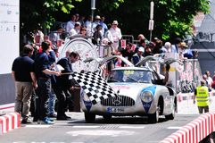 Jochen Mass finishes the 1000 Miglia classic car race Stock Photos