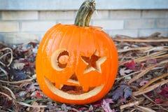 Jock o lantern. Orange carved jack o lantern with star and moon eyes Stock Photo