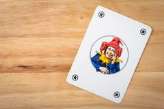 Cards Game Joker. Jocker card on a wood background Royalty Free Stock Images