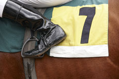 Jockey boot detail and race horse Royalty Free Stock Photo
