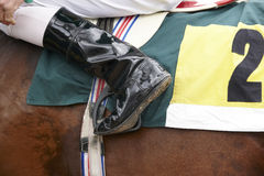 Jockey boot detail and race horse Stock Photography
