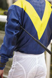 Jockey detail before the race. Hippodrome background. Racehorse. Competition Royalty Free Stock Photo
