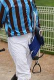 Jockey detail after the race. Hippodrome background. Racehorse. Stock Image