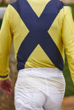 Jockey detail after the race. Hippodrome background. Racehorse. Competition Royalty Free Stock Image