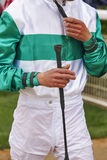 Jockey detail after the race. Hippodrome background. Racehorse. Competition Royalty Free Stock Photos