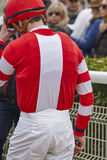 Jockey detail after the race. Hippodrome background. Racehorse. Competition Royalty Free Stock Photography