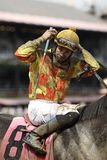 Jockey Eddie Castro removes his mud covered goggle Stock Images