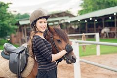 Jockey girl and her horse Stock Photos
