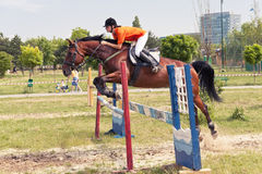 Jockey and horse jumping Stock Photo