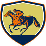 Jockey Horse Racing Shield Woodcut. Illustration of horse and jockey racing viewed from the side set inside shield crest on isolated background done in retro Royalty Free Stock Image
