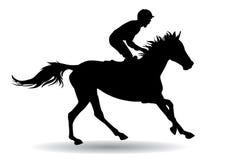 Jockey on a horse Stock Photos
