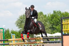 Jockey jumps over a hurdle Royalty Free Stock Photography