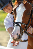 Jockey with purebred horse Royalty Free Stock Photo