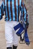 Jockey after the race. Hippodrome background. Racehorse. Royalty Free Stock Photography