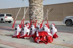 Jockey Robots at the Camel Race Stock Photo