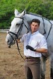 Jockey stand near horse Stock Photo