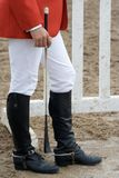 Jockey wearing riding boots. Jockey wearing black leather riding boots Stock Images