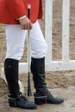 Jockey wearing riding boots. Jockey wearing black leather riding boots stock images