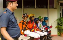 Jockeys at Hyderabad Race Club. HYDERABAD, ANDHRA PRADESH, INDIA - JANUARY 6: Jockeys waiting to mount their horses at the parade ring, Hyderabad Racing Club Stock Photo