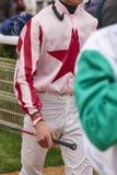 Jockeys after the race. Hippodrome background. Racehorse. Stock Photos
