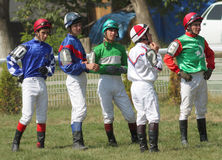 The Jockeys waiting for his ride. Stock Images