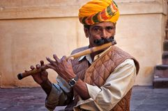 JODHPUR, INDIA - FEBRUARY 28, 2013: Undefined man playing on the flute in the Jodhpur fort Stock Photos